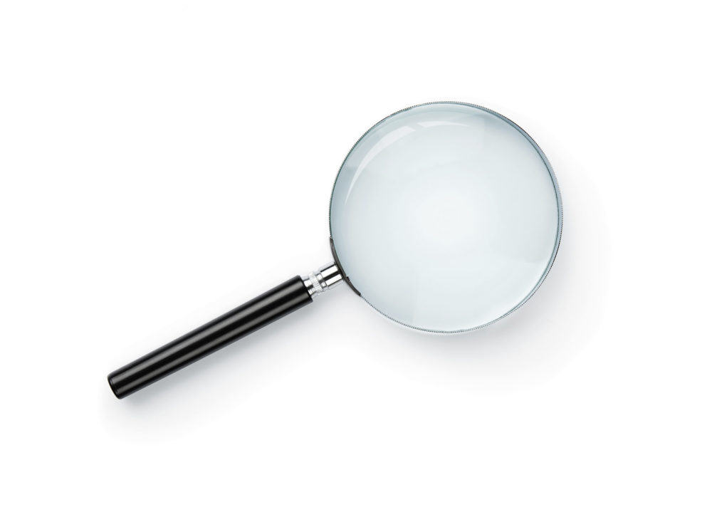A Magnifying Glass With A Black Handle On White Background